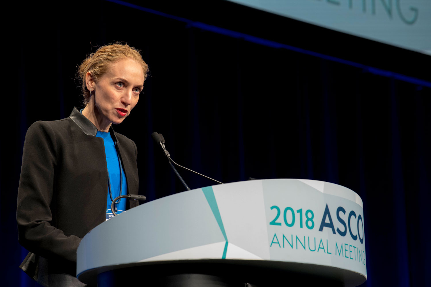 Georgina Long speaking at ASCO18
