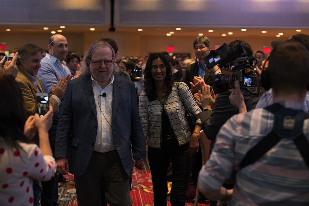 Dr. James P. Allison, 2018 Nobel Laureate, and Dr. Padmanee Sharma, his wife, make their way through a standing ovation at CICON18