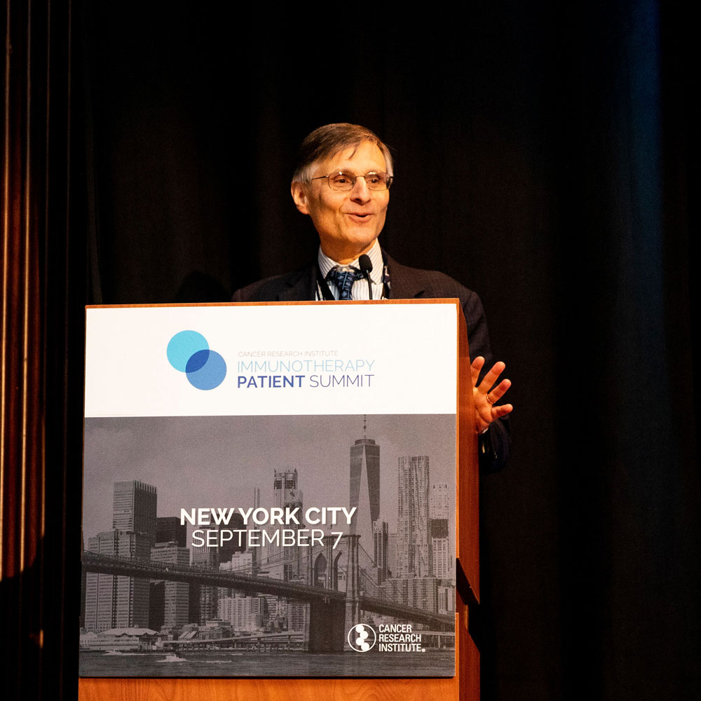 Dr. Ben Neel welcomes attendees to the fourth CRI Immunotherapy Patient Summit in New York City, held at NYU Langone's Perlmutter Cancer Center. Photo by Hannah Cohen.