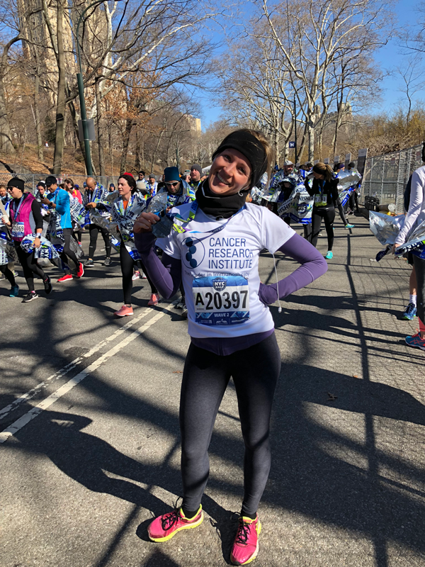 Anne Asmus with her medal at the 2018 NYC Half Marathon.