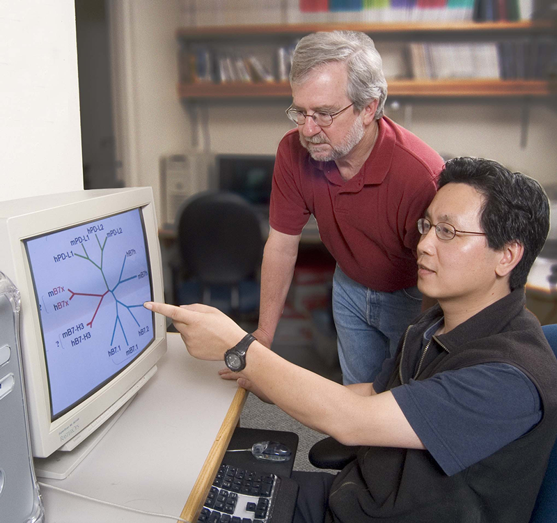 Dr. james Allison with CRI postdoctoral fellow XingXing Zang