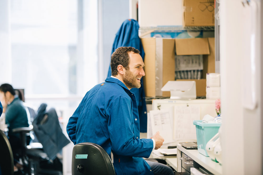 Dr. Alexander Marson sitting in his laboratory at UCSF. Photo by Anastasiia Sapon.