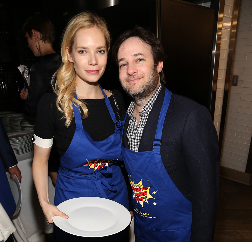 Caitlin Mehner and Danny Strong in aprons to go Through the Kitchen.