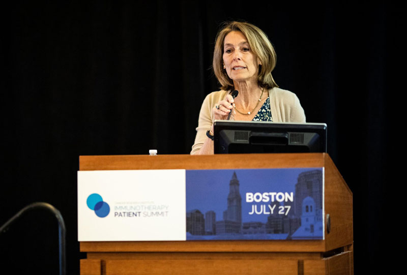 Laurie Glimcher, M.D., welcome attendees to the first CRI Immunotherapy Patient Summit in Boston, held at the Dana-Farber Cancer Institute. Photo by Adrianne Mathiowetz.