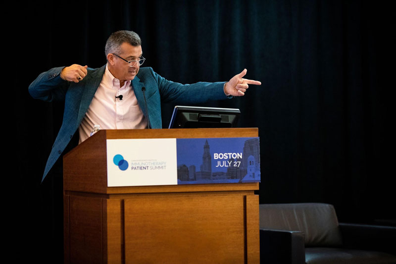 Dr. David Reardon explains during his immunotherapy basics presentation how immune cells operate like trained assassins with specific targets. Photo by Adrianne Mathiowetz.