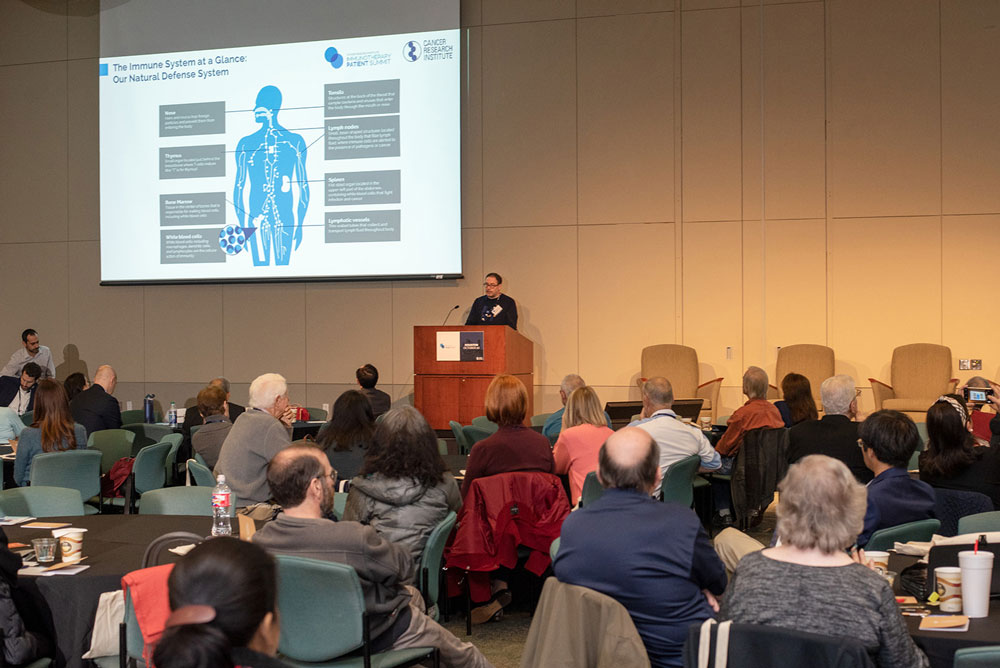 Dr. Adi Diab discusses the basics of immunotherapy. Photo by Ranjani Groth