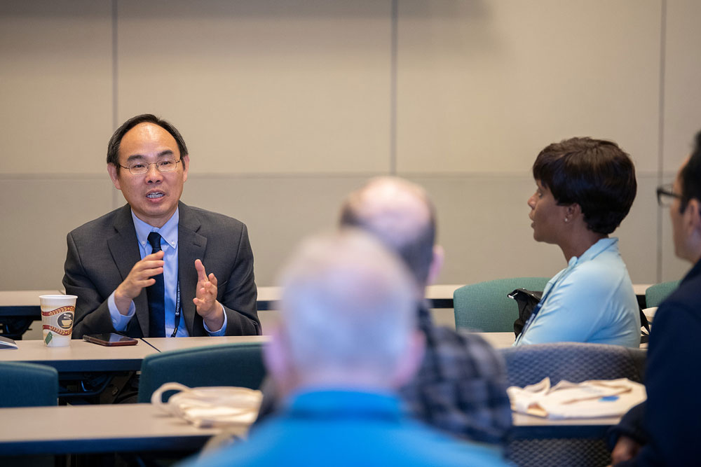 Dr. Gao answers questions about relevant biomarkers in kidney and bladder cancer during the genitourinary cancer breakout session. Photos by Ranjani Groth