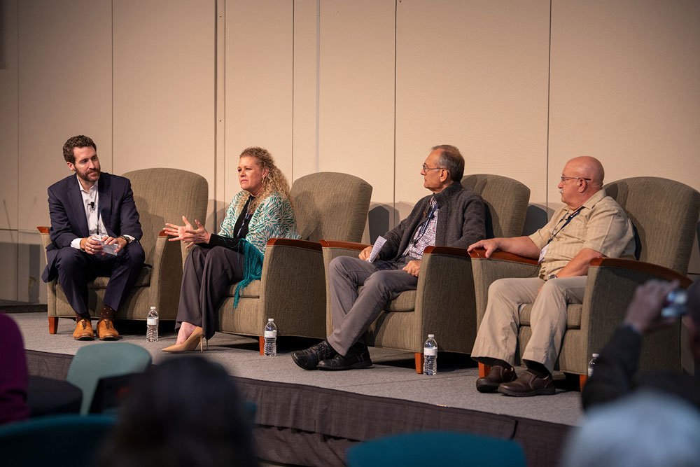 Moderator Brian Brewer (left) with panelists Isolde Artz, Samir Tanios, and Ron Speidel. Photo by Ranjani Groth