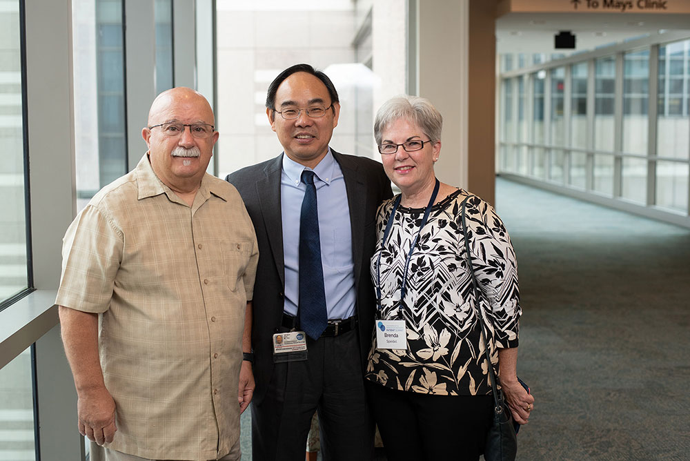 Ron Speidel (left) with his oncologist Dr. Jian Jun Gao and his wife, Brenda Speidel. Photo by Ranjani Groth