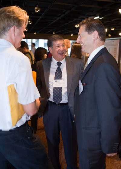 Schreiber, conversing with colleagues Mark J. Smyth, Ph.D., and Jonathan  Cebon, Ph.D., at a CRI Symposium in 2007.