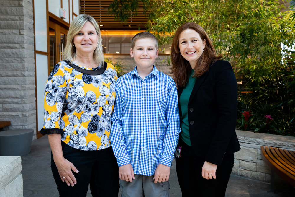Mother Denise, patient Cole, and Dr. Susanne Baumeister. Photo by Adrianne Mathiowetz