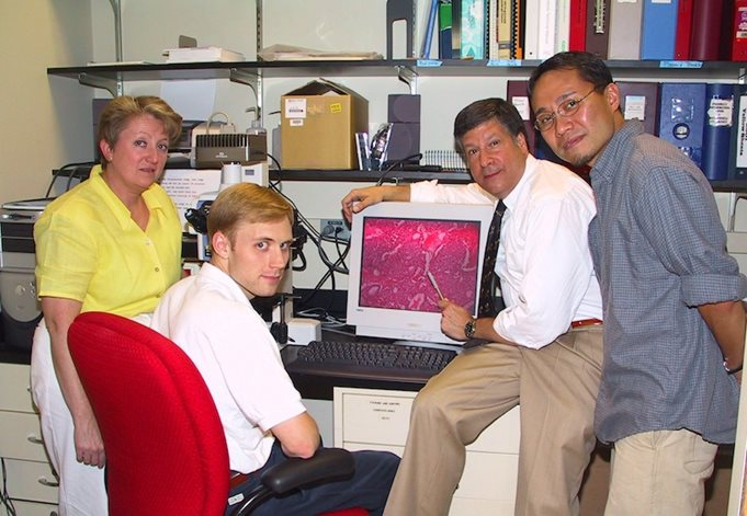 From L to R: Kathleen Sheehan, Ph.D., Allen T. Bruce, M.D., Ph.D., Schreiber, and Hiroaki Ikeda, M.D., Ph.D. Bruce and Ikeda both contributed to Schreiber's landmark 2001 paper on immunoediting, and both were supported by CRI funding.
