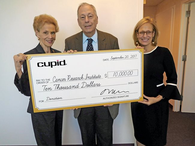 David and Marilyn Welsch (Cupid Intimates) presenting the check to Sharon Slade